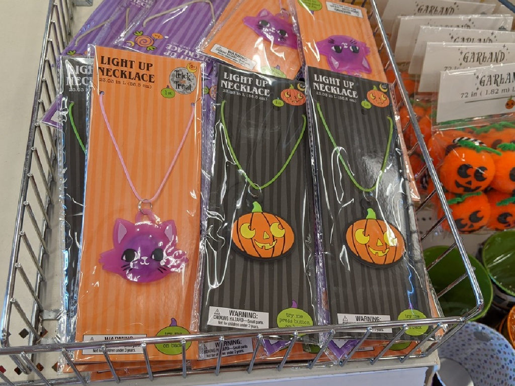 packages of halloween themed neckalces on store shelf