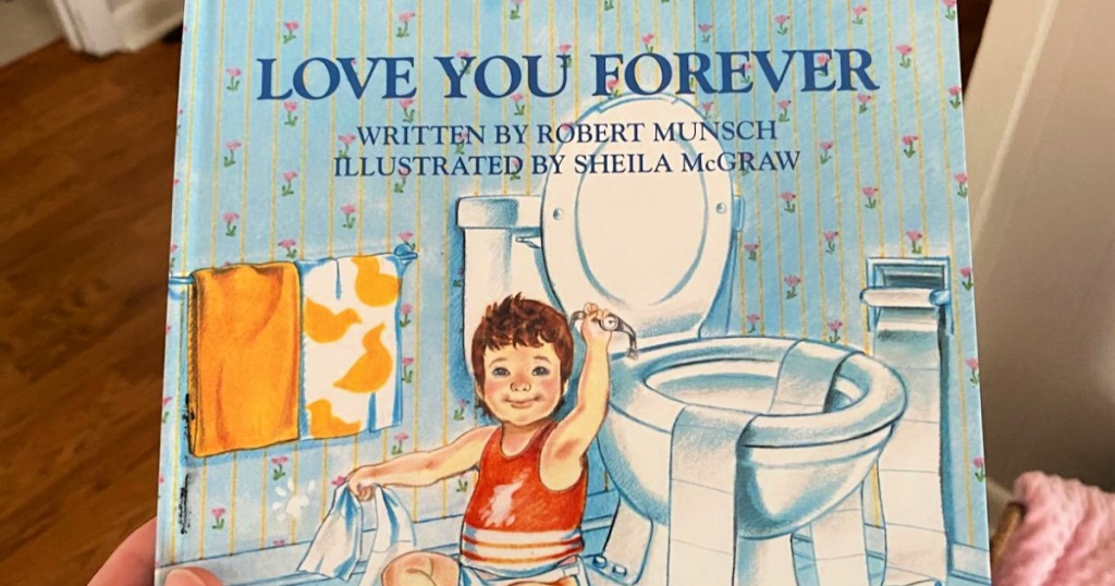 hand holding love you forever book