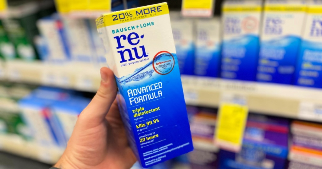 man holding bottle of renu contact solution