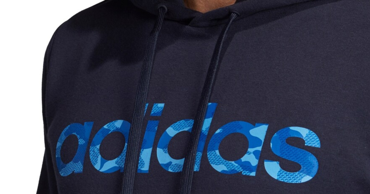 Men's adidas pullover hoodie in blue a close up of the upper logo portion of the sweatshirt in blue