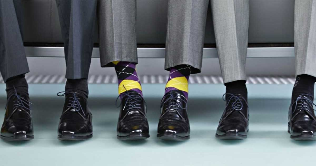 men wearing suits with dress socks