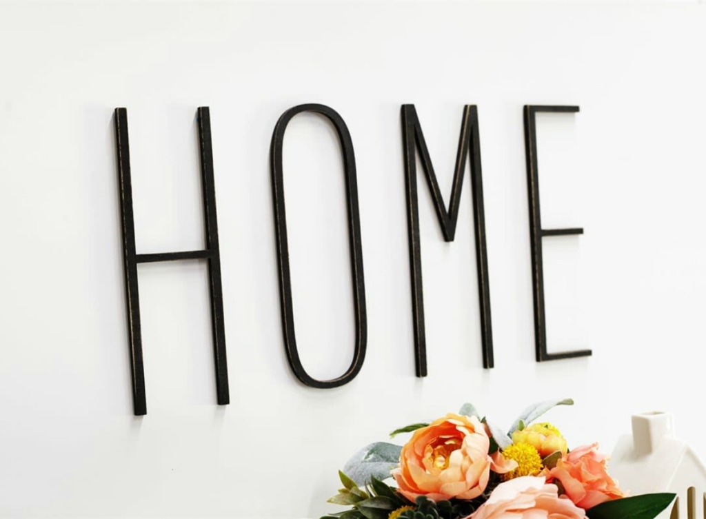 metal letters that spell the word home