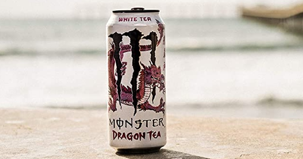 can of tea sitting on a beach