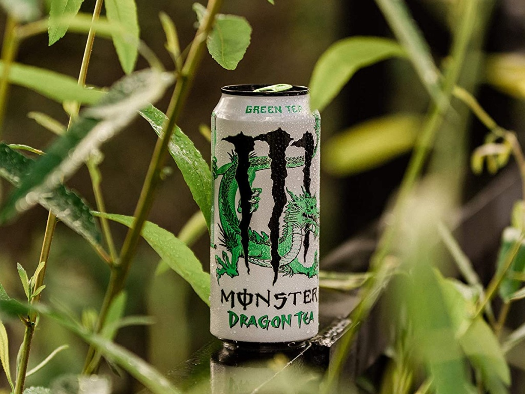 can of tea by green plants