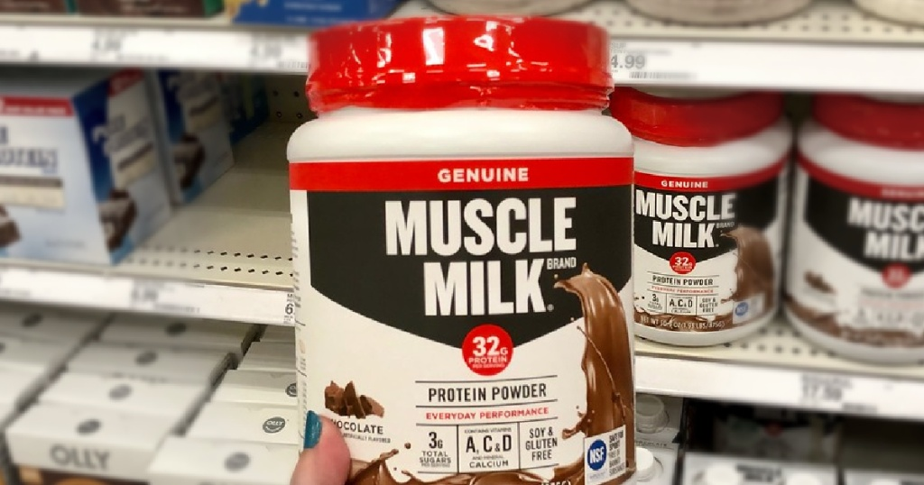 muscle mik protein powder in person's hand