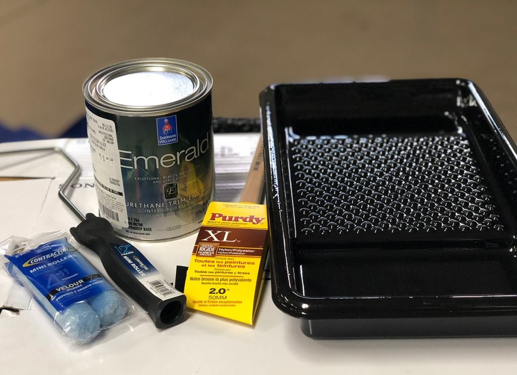painting supplies with paint can from sherwin williams, paint brushes, and paint tray