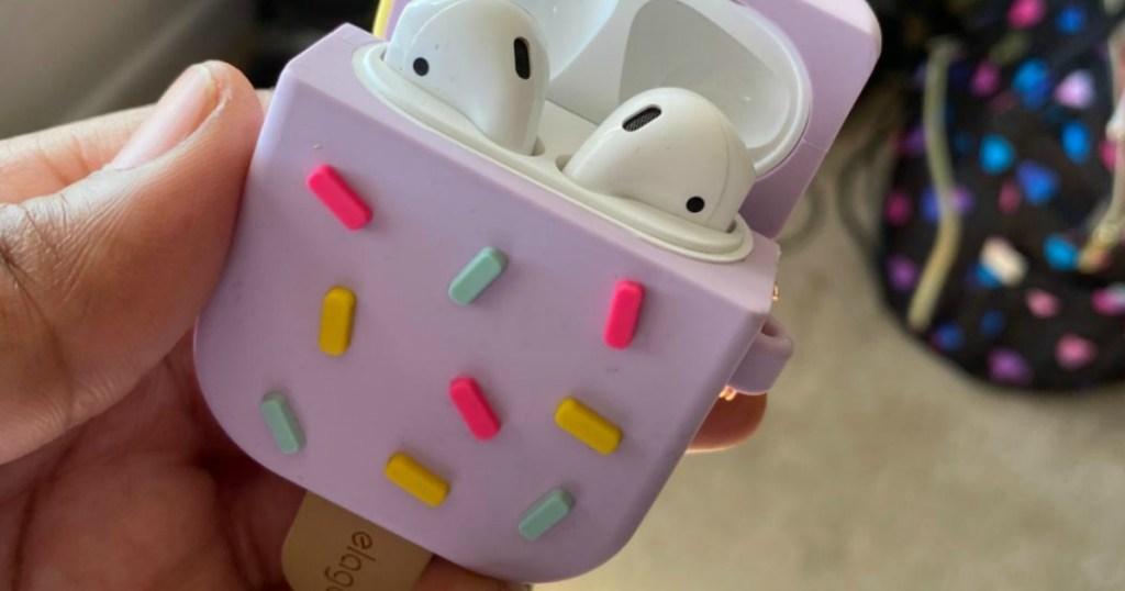 holding cute ice cream bar airpod case