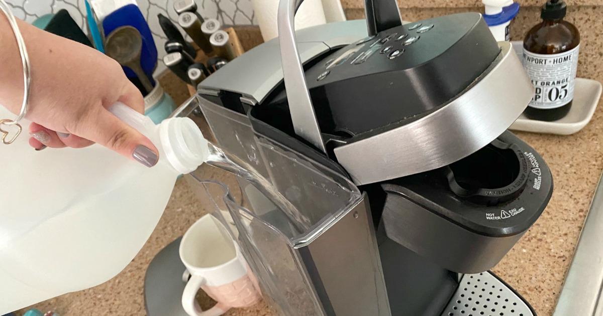 pouring vinegar into reservoir