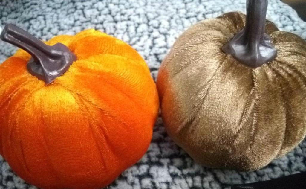orange and brown velvet pumpkin sitting on table