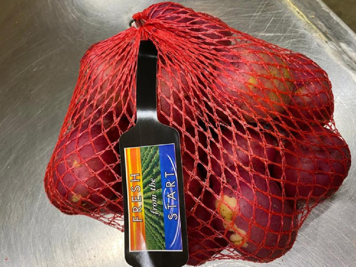 mesh bag of red potatoes