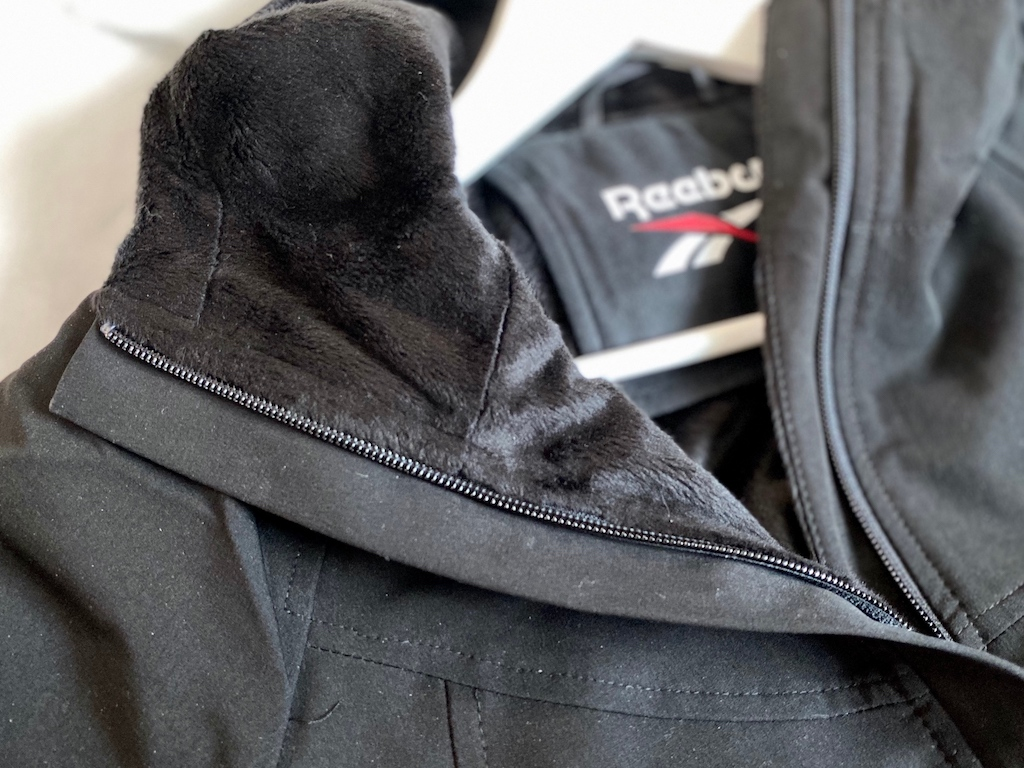close up of Reebok jacket with fur-lining inside