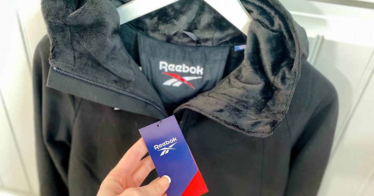Reebok faux-fur lined jacket on hanger with tag