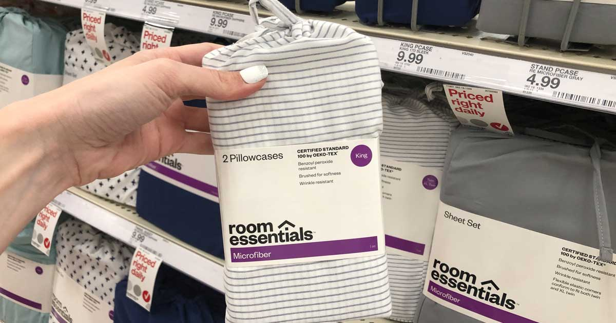 hand holding a set of room essentials sheet sets