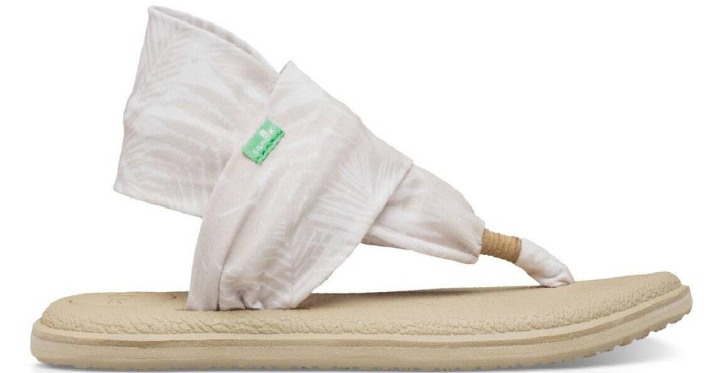 white fabric flip flops