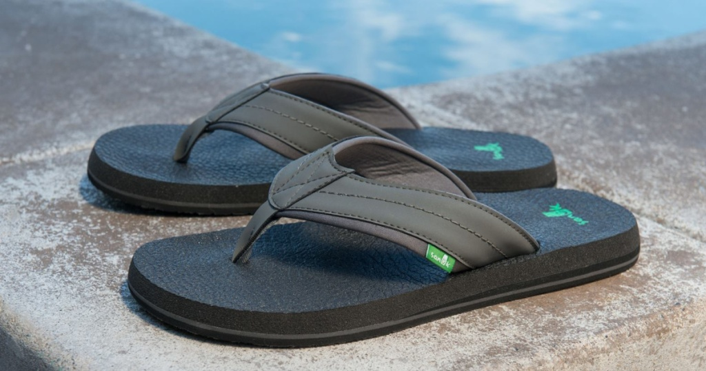 brown flip flops by pool