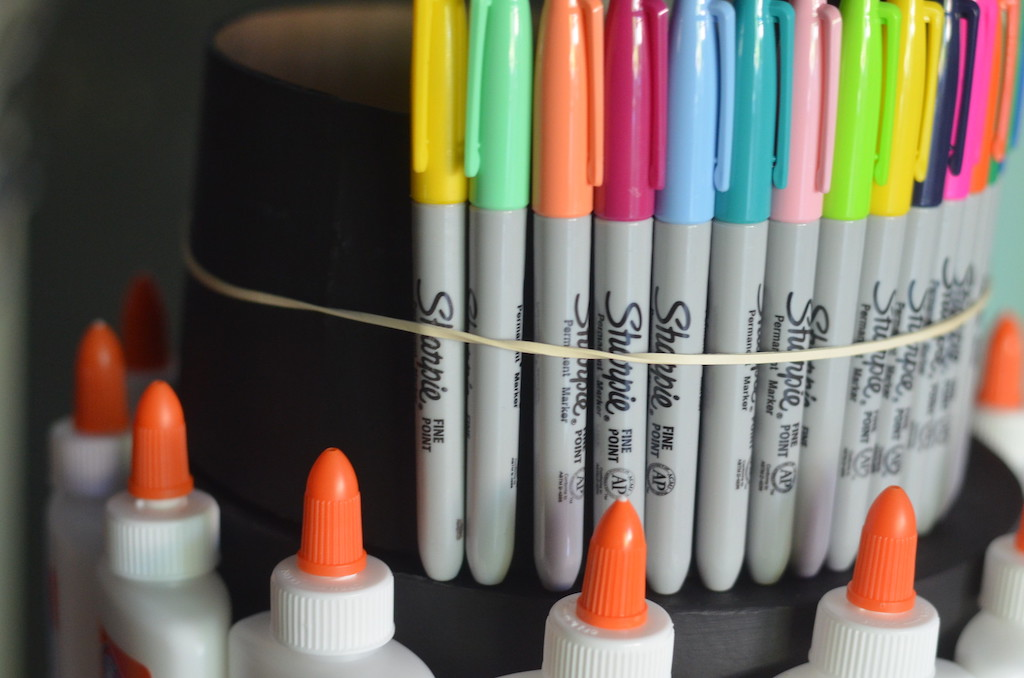 Sharpie markers attached to box with rubber bands