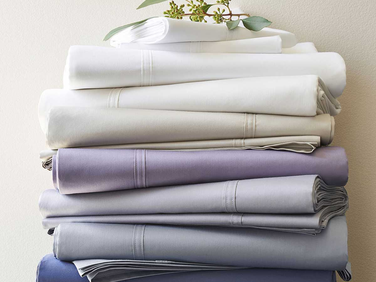 multi colored sheet sets stacked up