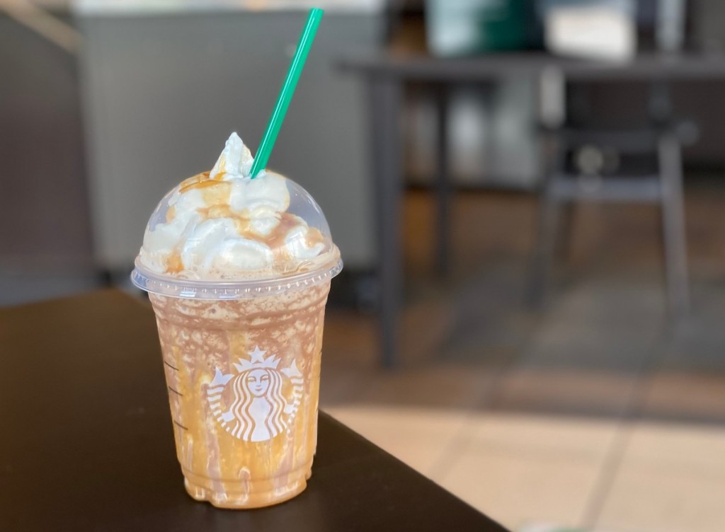 starbucks snickers frappuccino sitting on table