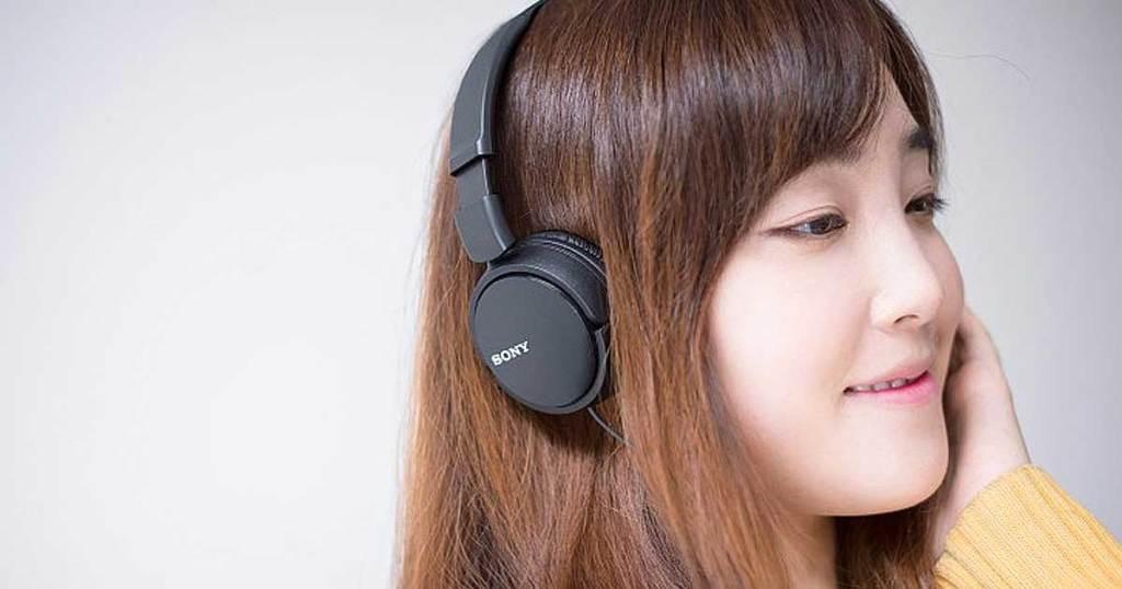 name brand headphones on woman