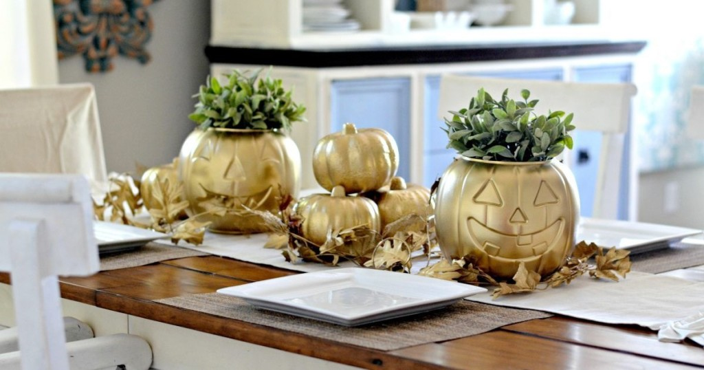 spray painted gold pumpkins on table