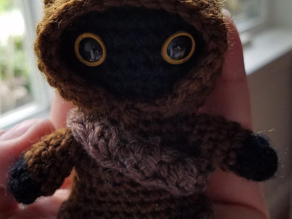 hand holding small crocheted character from Star Wars