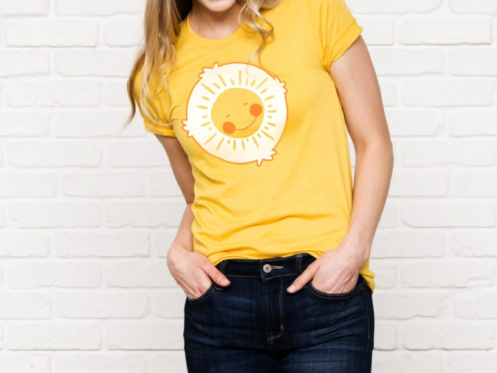 woman wearing yellow t shirt and jeans