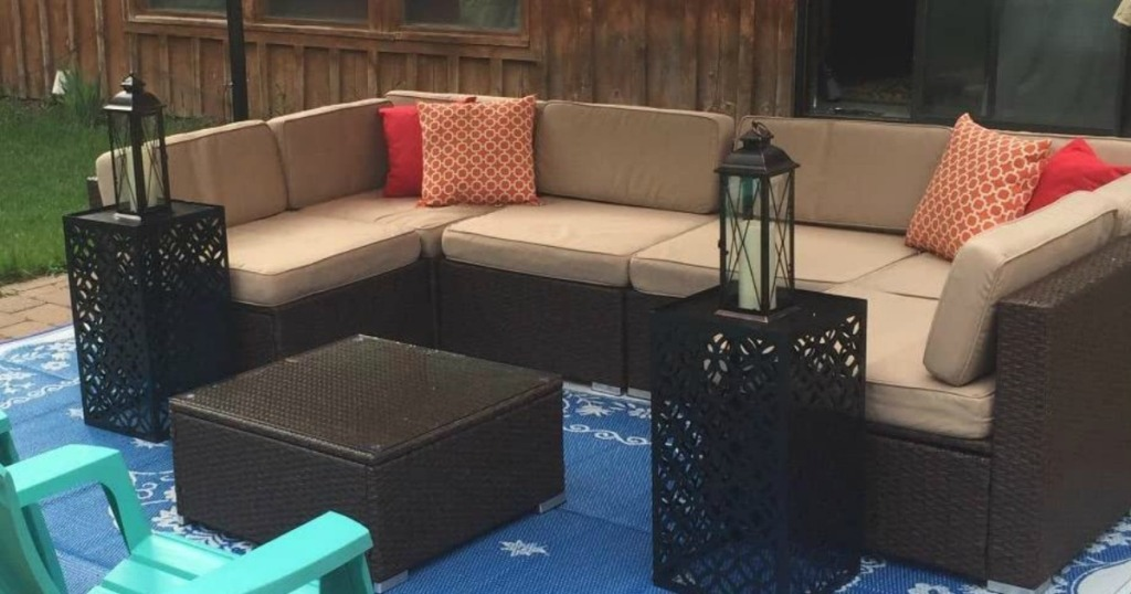 tan and brown outdoor wicker furniture outside home