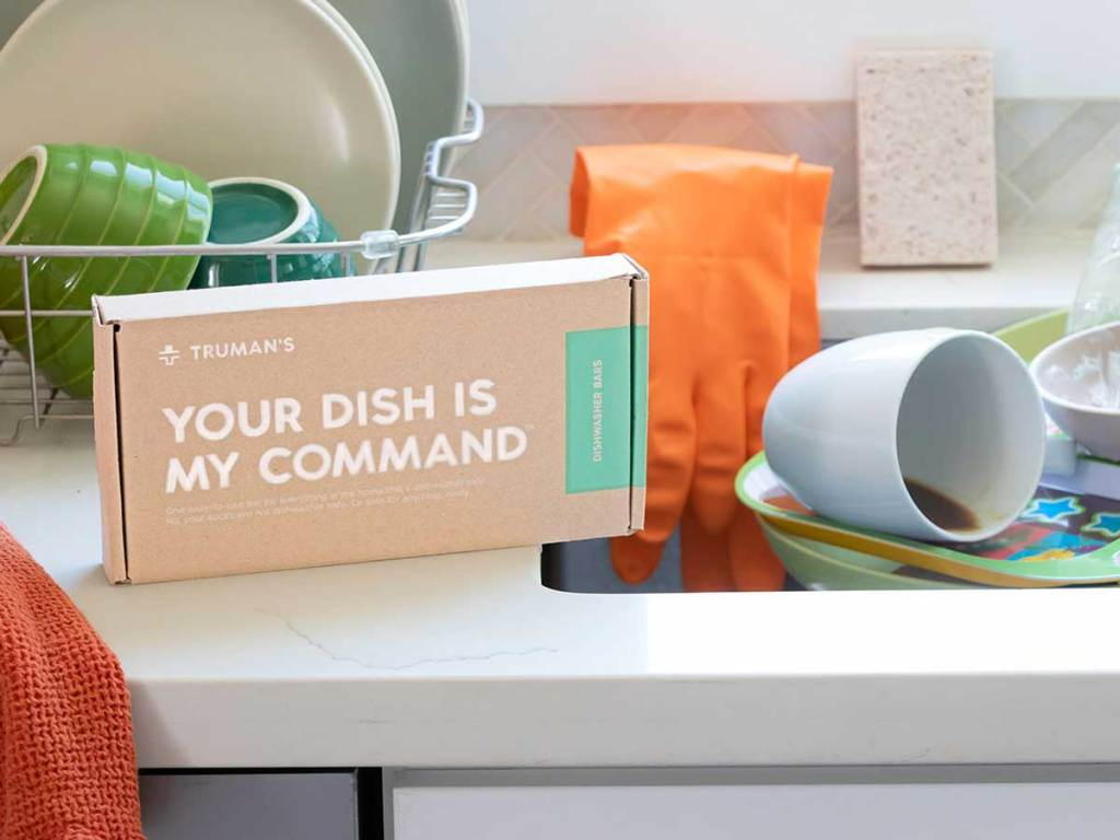 dishwashing bars on a counter near dirty dishes