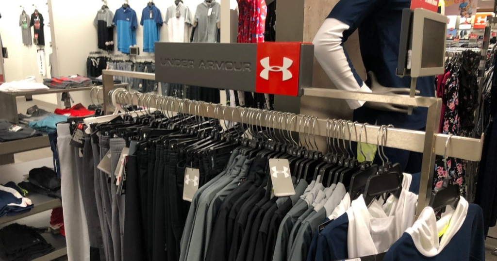 store with Under Armour brand apparel on hangers