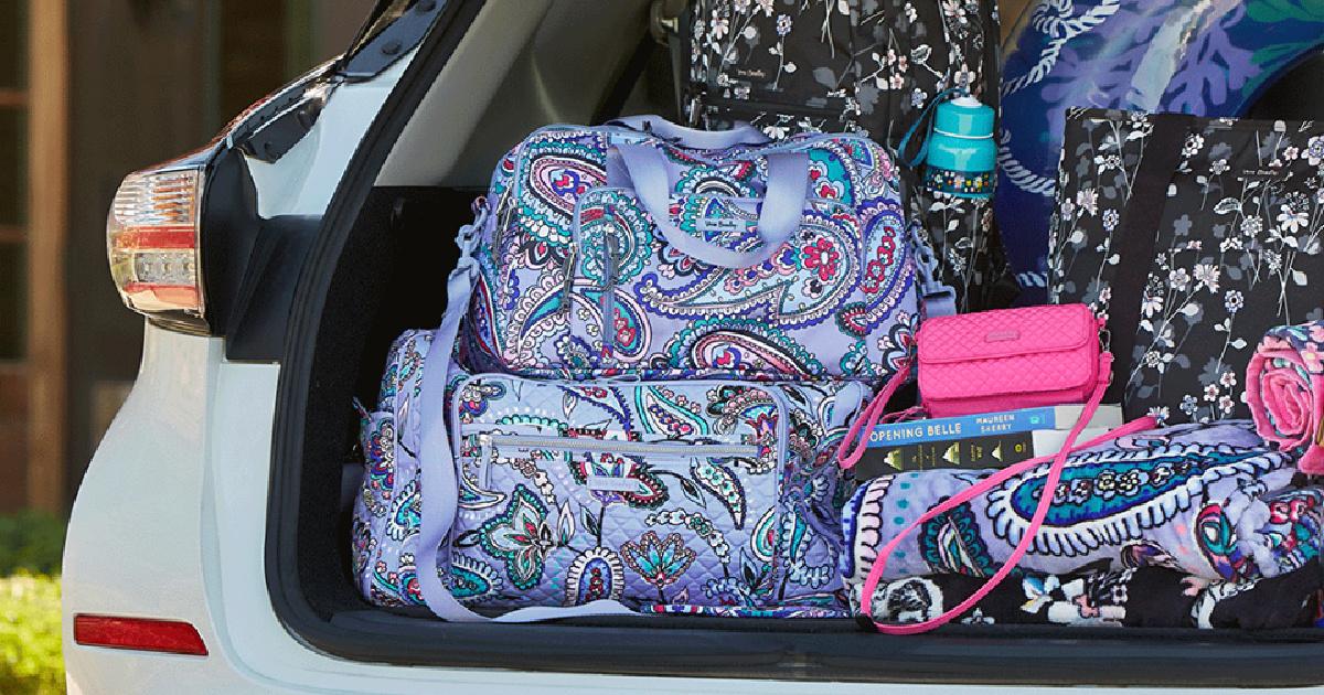 multiple vera bradley travel bags in trunk