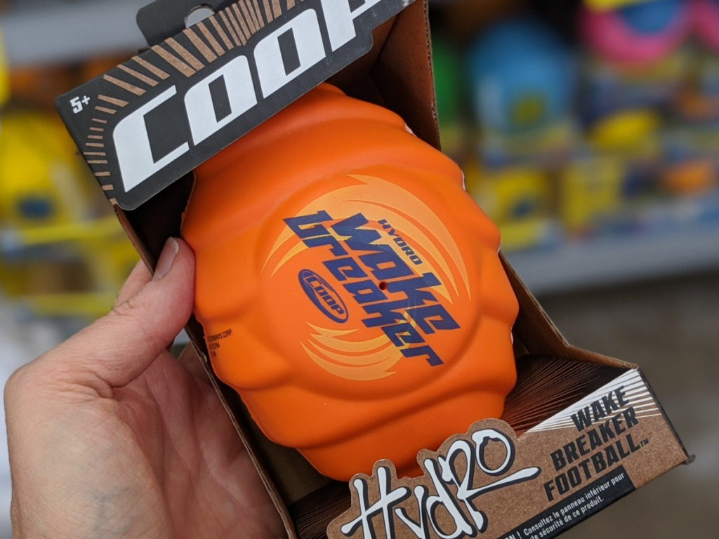hand holding water toy shaped like football