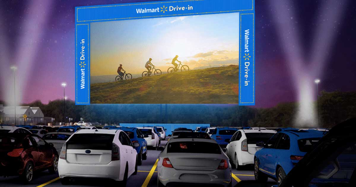 Large outdoor movie screen in a parking lot