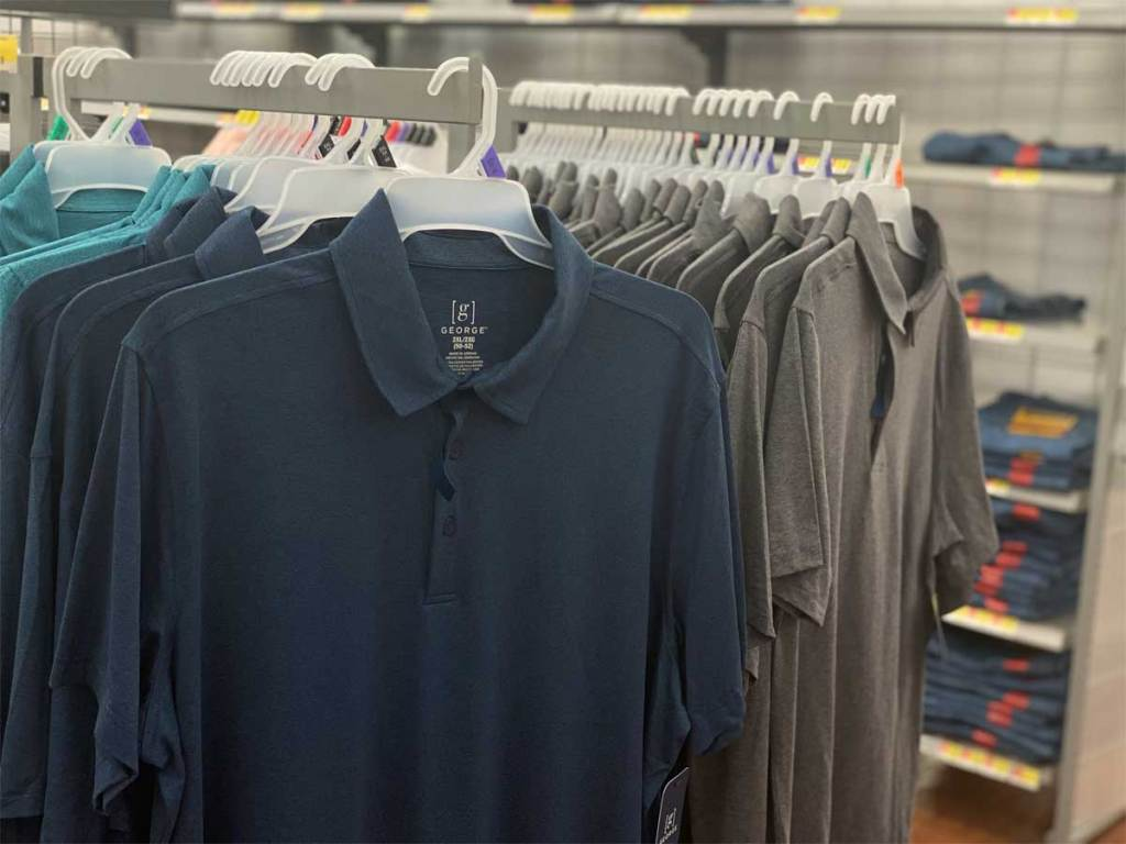 men's polo shirts on display in store