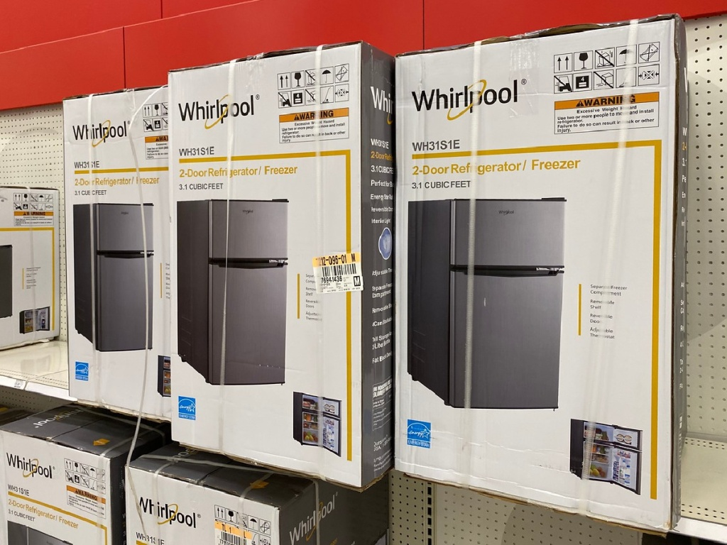 boxes with small refrigerators on them in a store