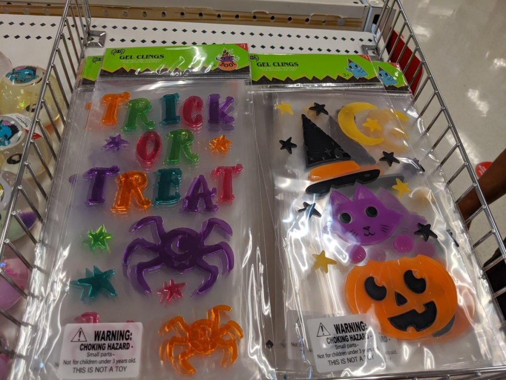 store shelf with packages of halloween window clings