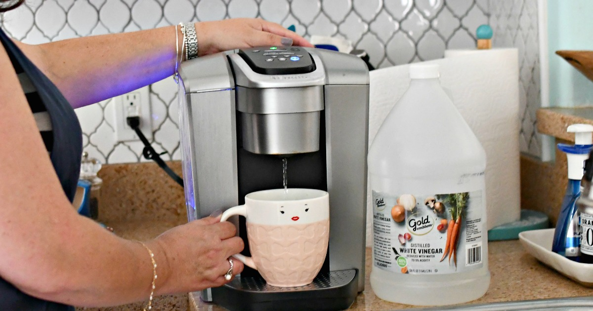 woman cleaning a Keurig machine with vinegar