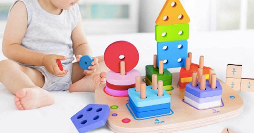 little toddler playing with puzzle