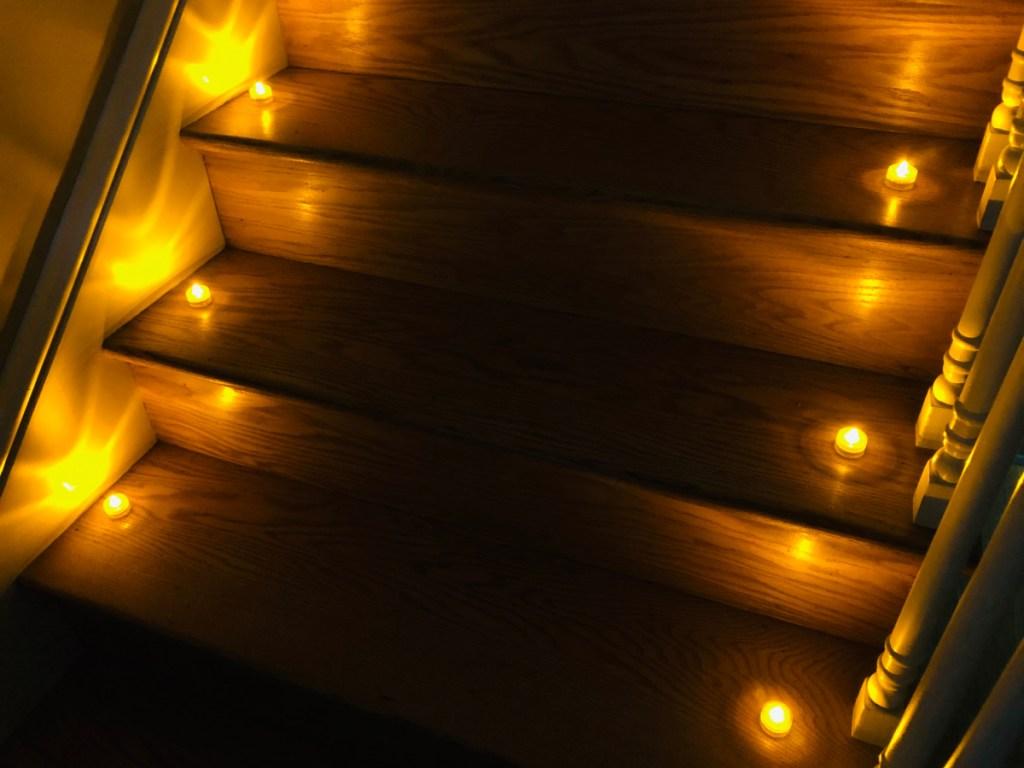 yellow tea lights lining stairs