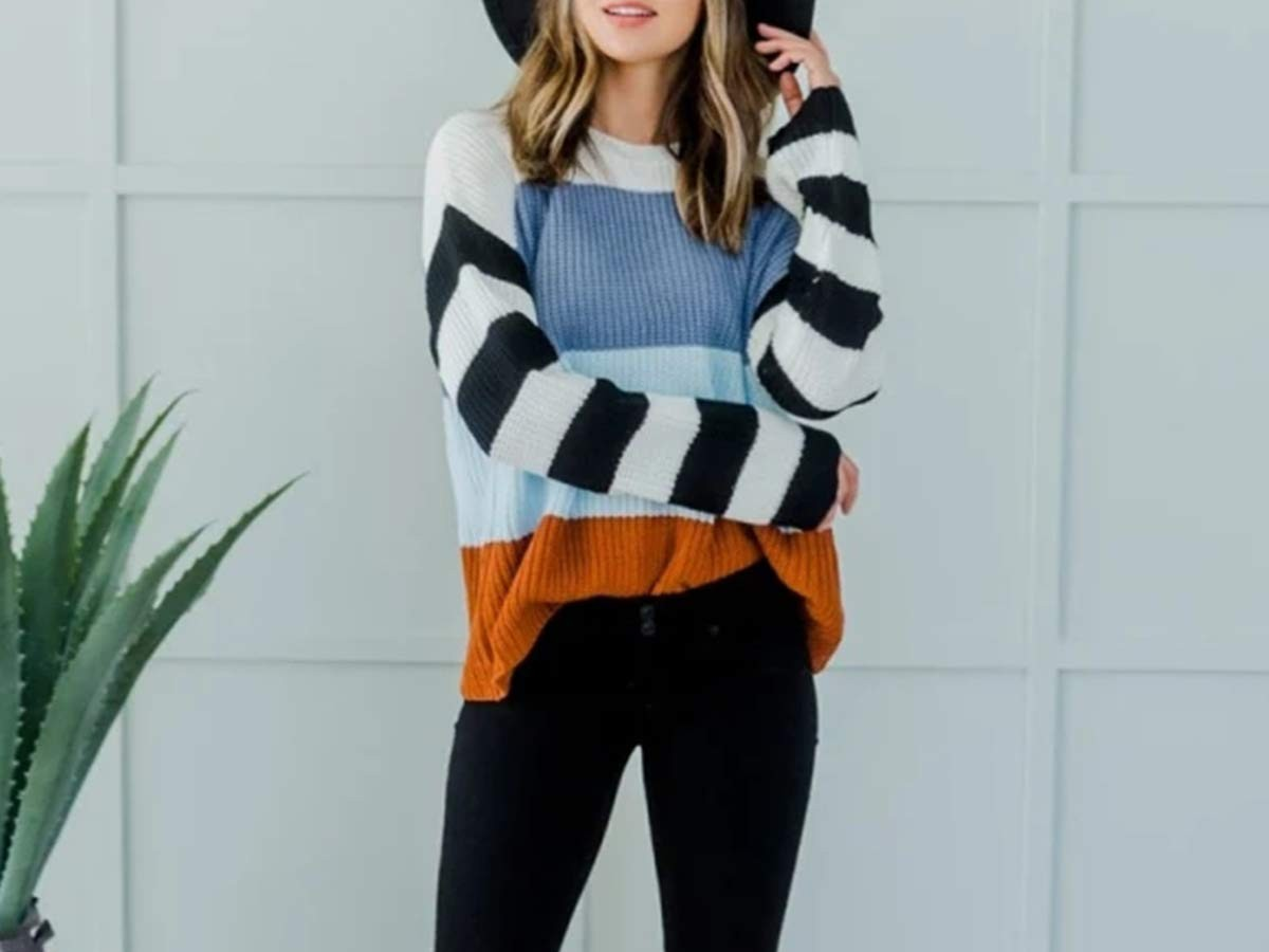 woman wearing colorblock sweater and black pants