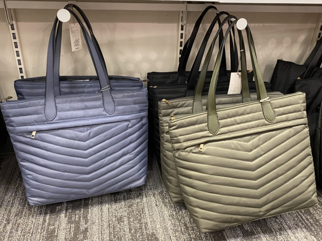 quilted handbags hanging in store