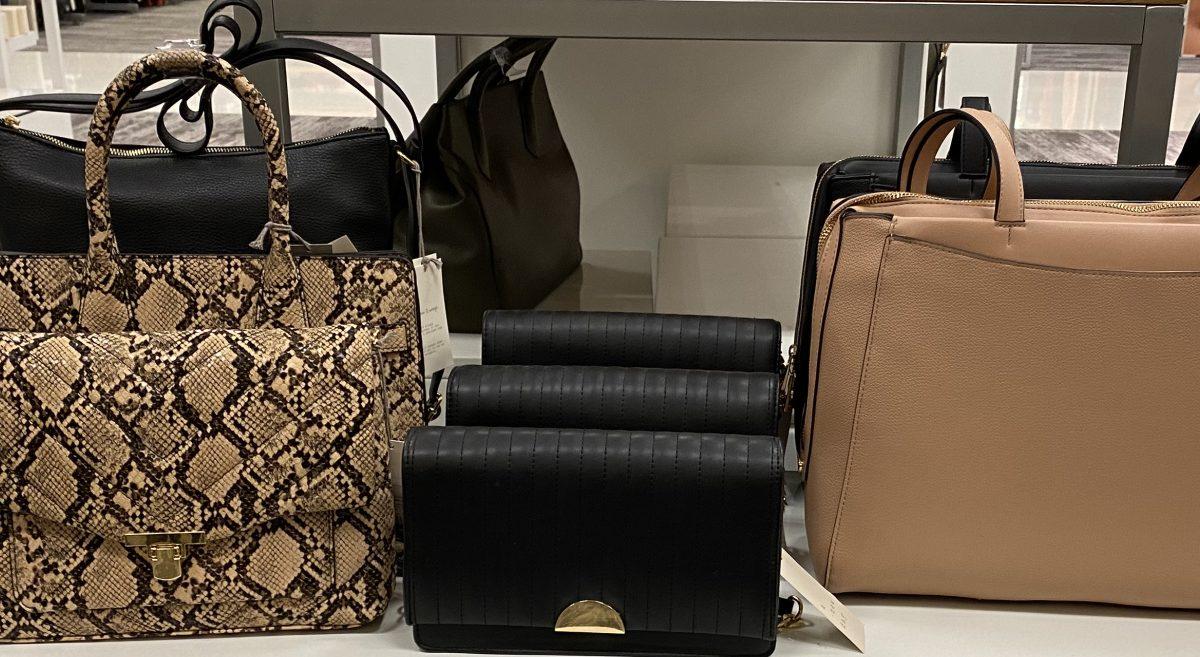 handbags on display table in store