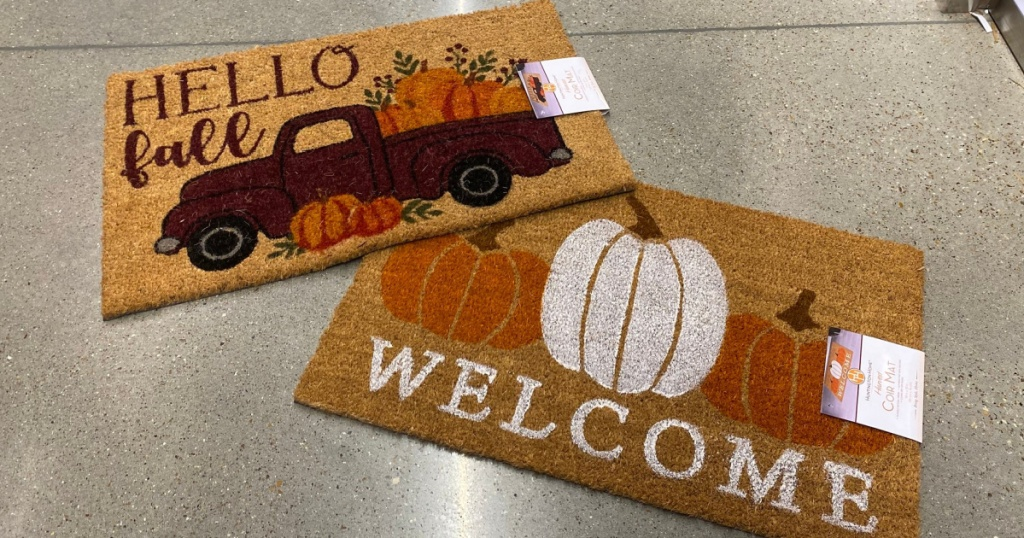 ALDI doormats for fall with truck and pumpkins