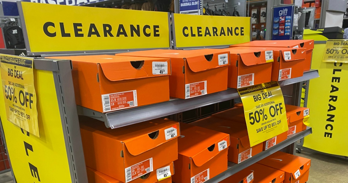 In-store clearance rack with boxes of Nike shoes