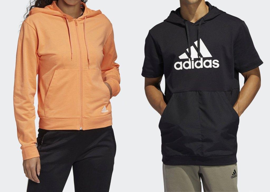 woman modeling orange adidas zip-up jacket and man modeling black adidas short sleeve hoodie