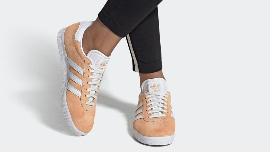 person wearing orange sneakers