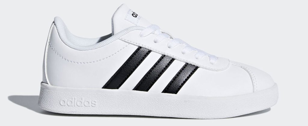 white adidas kids sneaker with three black stripes on side