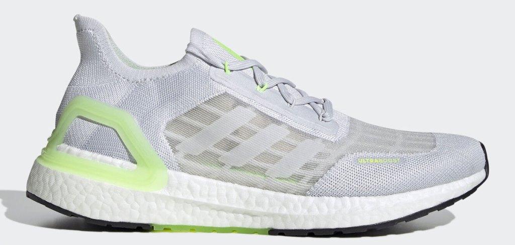 light grey and green adidas mesh running shoe