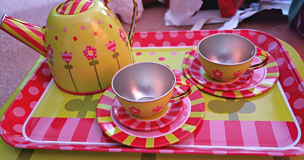 toy tea cups, tea kettle, tray, and plates