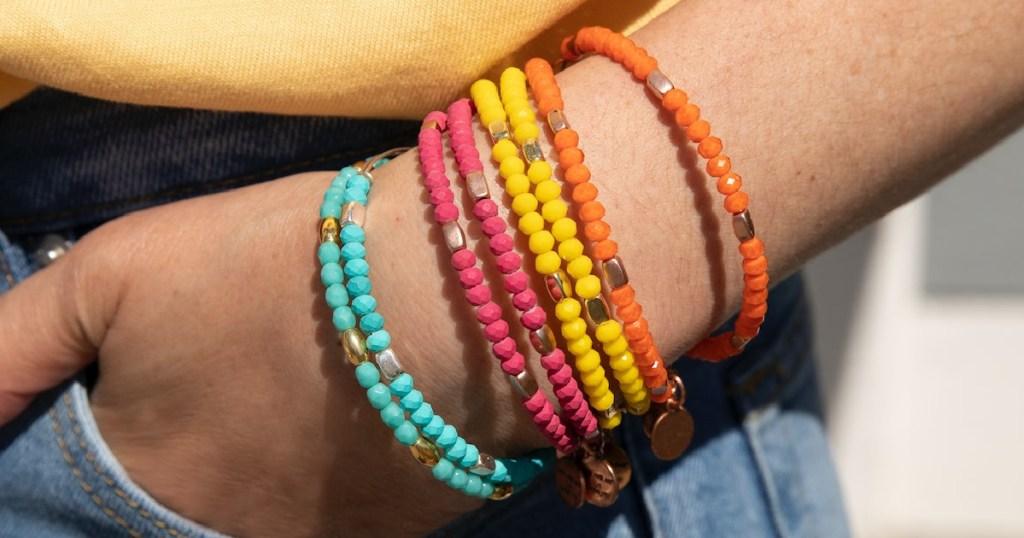 colorful beaded bracelets on wrist