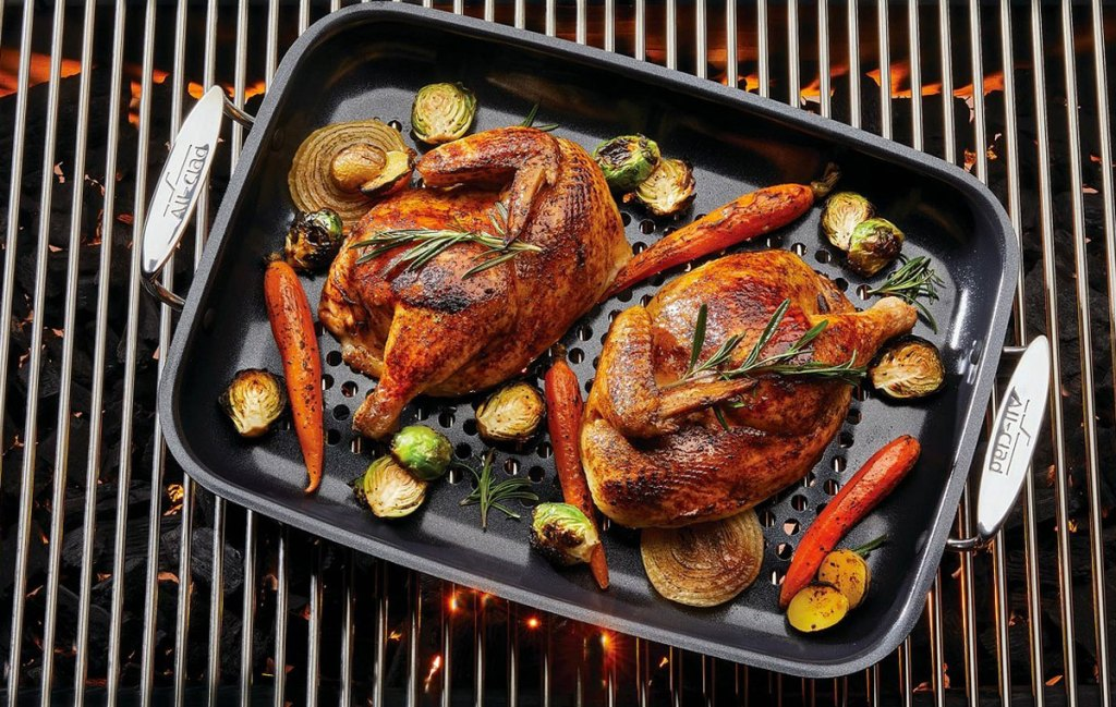 rectangular non-stick roasting pan on grill with roasted chicken and vegetables